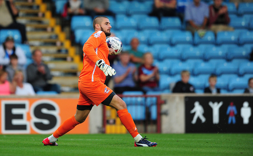 Scunthorpe United's Joe Anyon in action during todays match  <br /> <br /> Photographer Chris Vaughan/CameraSport<br /> <br /> Football - Capital One Cup First Round - Scunthorpe United v Barnsley - Tuesday 11th August 2015 - Glanford Park - Scunthorpe<br />  <br /> &copy; CameraSport - 43 Linden Ave. Countesthorpe. Leicester. England. LE8 5PG - Tel: +44 (0) 116 277 4147 - admin@camerasport.com - www.camerasport.com