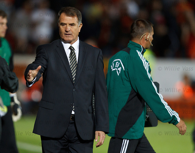 AEK Manager Dusan Bajevic commiserates with the Dundee Utd bench after the match