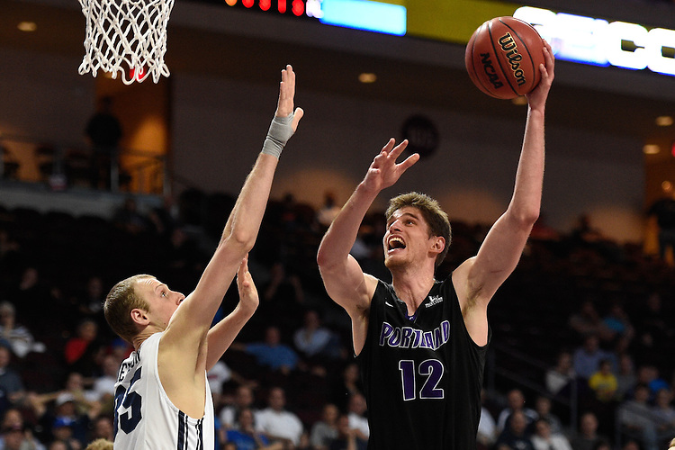 March 9, 2015; Las Vegas, NV, USA; Portland Pilots center Thomas van der Mars (12) shoots the basketball against Brigham Young Cougars forward Isaac Neilson (35) during the second half of the WCC Basketball Championships at Orleans Arena.