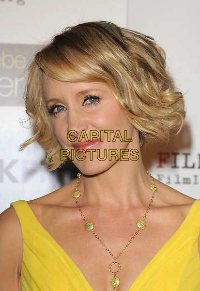 "FELICITY HUFFMAN .at The ThinkFilm Special Screening of ""Phoebe in Wonderland"" held at The WGA in Beverly Hills, California, USA, .March 1st 2009.                                                                     .portrait headshot  bright yellow gold necklace wavy hair bob .CAP/DVS.©RockinExposures/Capital Pictures"