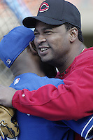 Jose Rijo of the Cincinnati Reds hugs a member of the Los Angeles Dodgers before a 2002 MLB season game at Dodger Stadium, in Los Angeles, California. (Larry Goren/Four Seam Images)