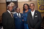Chaplain Paschal l. Odemokpa stands with military clothes tailor, his son, and mother
