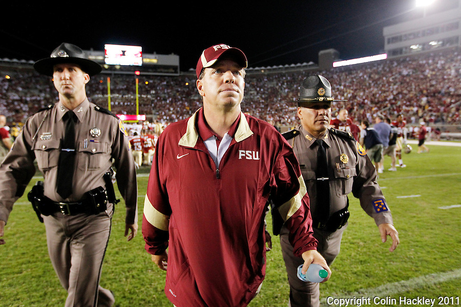 TALLAHASSEE, FL 9/17/11-FSU-OU091711 CH-Florida State's Head Coach Jimbo Fisher, center, leaves the field after the 23-13 loss to Oklahoma Saturday at Doak Campbell Stadium in Tallahassee. COLIN HACKLEY PHOTO