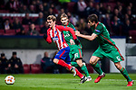 Antoine Griezmann (L) of Atletico de Madrid is followed by Mikhail Lysov (C) and Nemanja Pejcinovic of FC Lokomotiv Moscow during the UEFA Europa League 2017-18 Round of 16 (1st leg) match between Atletico de Madrid and FC Lokomotiv Moscow at Wanda Metropolitano  on March 08 2018 in Madrid, Spain. Photo by Diego Souto / Power Sport Images