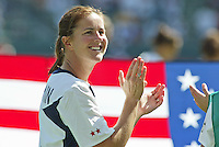 Brandi Chastain claps and smiles at the crowd before the USA vs Canada, 2003 WWC Consolation Finals.