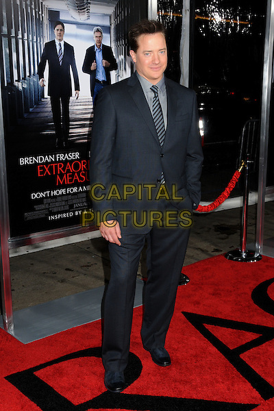 "BRENDAN FRASER .""Extraordinary Measures"" Los Angeles Premiere held at Grauman's Chinese Theatre, Hollywood, California, USA..January 19th, 2010.full length suit jacket black blue hand in pocket grey gray.CAP/ADM/BP.©Byron Purvis/AdMedia/Capital Pictures."