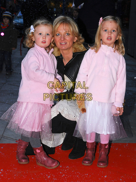 "ALICE BEER & DAUGHTERS.At ""The Snowman"" Press Night, .Peacock Theatre, London, England, .December 9th 2006..full length children girls pink fairy tutu skirts family kneeling bending.CAP/CAN.©Can Nguyen/Capital Pictures"