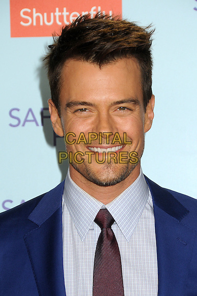 "Josh Duhamel.""Safe Haven"" Los Angeles Premiere held at the TCL Chinese Theatre, Hollywood, California, USA..February 5th, 2013.headshot portrait purple tie shirt blue suit stubble facial hair smiling .CAP/ADM/BP.©Byron Purvis/AdMedia/Capital Pictures."