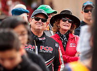 Feb 23, 2020; Chandler, Arizona, USA; NHRA top fuel driver Billy Torrence (left) with wife Kay Torrence during the Arizona Nationals at Wild Horse Pass Motorsports Park. Mandatory Credit: Mark J. Rebilas-USA TODAY Sports