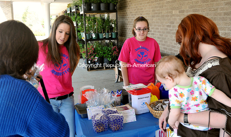 SOUTHBURY, CT-25 APRIL 2009 --042509JS04--Liza Flaherty, left, and Jennifer Biereder, right, both members of the Southbury Juniorettes, talk with customers during a bake sale Saturday outside the K-Mart in the Southbury Shopping Center. The group was raising money for the Middlebury's Animals for Life, a not for profit humane organization. <br /> Jim Shannon Republican-American