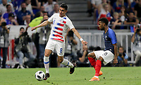 Lyon, France - Saturday June 09, 2018: Joe Corona, Thomas Lemar during an international friendly match between the men's national teams of the United States (USA) and France (FRA) at Groupama Stadium.