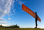 The Angel of the North located near Newcastle upon Tyne, England is a metal, modern art sculpture that can be seen for miles.