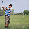 Oscar Guevara, 14, of Inwood practices his golf swing at the driving range of of Lawrence Yacht and Country Club on Tuesday, June 7, 2016.
