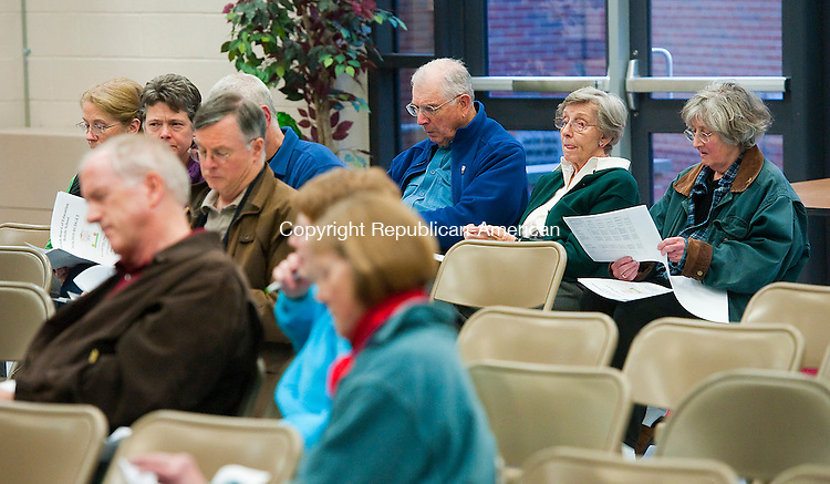 NORFOLK, CT-0426014JS02-Norfolk residents listed to Board of Finance Chairman J. Michael Sconyers as he talks about the budget during the Town of Norfolk's hearing on the budget proposal for 2014-15. The finance board is proposing a newly 11 percent increase in taxes. <br /> Jim Shannon Republican-American