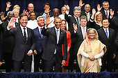 United States President Barack Obama (C) poses for a 'class photograph' with the Leaders' Summit on Peacekeeping participants during the 70th annual UN General Assembly at the UN headquarters September 28, 2015 in New York City. The White House helped to lead and secure new commitments of peacekeeping support from UN member countries. <br /> Credit: Chip Somodevilla / Pool via CNP