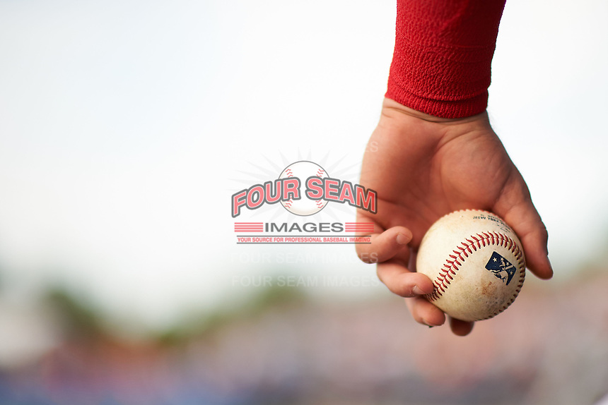 Batavia Muckdogs Ryan Cranmer holds a baseball in the dugout during a game against the Mahoning Valley Scrappers on July 3, 2015 at Dwyer Stadium in Batavia, New York.  Batavia defeated Mahoning Valley 7-4.  (Mike Janes/Four Seam Images)