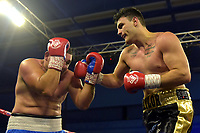 Naylor Ball (black shorts) defeats Ferenc Zsalek during a Boxing Show at Bracknell Leisure Centre on 8th July 2018