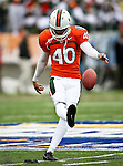Miami Hurricanes kicker Jake Wieclaw (40) practices kicking before the 2010 Hyundai Sun Bowl football game between the Notre Dame Fighting Irish and the Miami Hurricanes at the Sun Bowl Stadium in El Paso, Tx. Notre Dame defeats Miami 33 to 17...