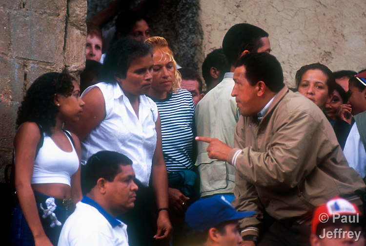Venezuelan President Hugo Chavez during a visit to the Caracas neighborhood of Catuche in January 2000 following Dec 1999 flooding.