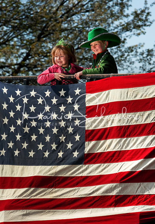 Kate Demore,4, and her brother Will DeMore,6, from Charlotte, North Carolina were all smiles as they road their St. Patrick's Day float down Tryon Street in the annual St. Patrick's Day Parade in Uptown/Downtown Charlotte, North Carolina. (Model Released)