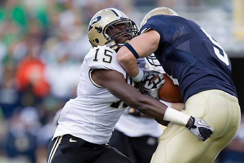 Purdue cornerback Charlton Williams (#15) tackles Notre Dame tight end Kyle Rudolph (#9) in game action during NCAA football game between the Notre Dame Fighting Irish and the Purdue Boilermakers.  Notre Dame defeated Purdue 23-12 in game at Notre Dame Stadium in South Bend, Indiana.