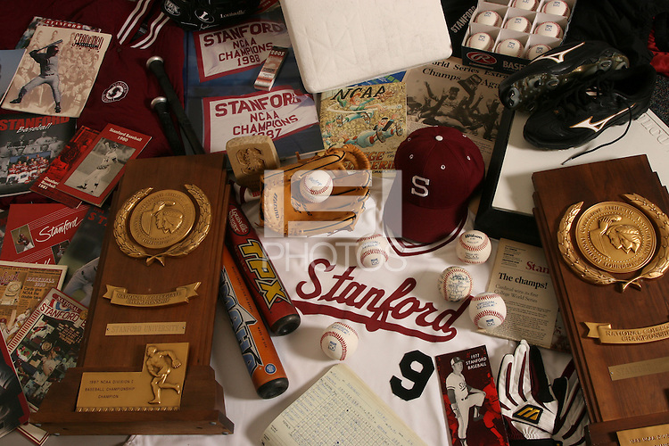 1 December 2005: Baseball cover shoot for the media guide. Memorabilia featuring cap, uniform, NCAA Championship trophy, baseball glove, baseballs, media guides and more.
