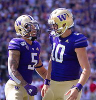 Jacob Eason and Andre Baccellia celebrate Eason's first touchdown pass as a Husky, a 50 yard bomb.