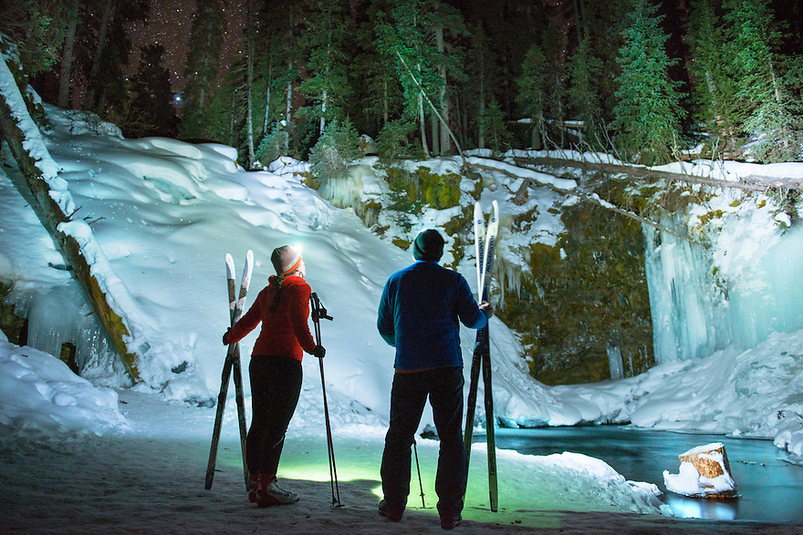 Erin McCleary, of Bozeman, left, and Ben Pierce take in the view of Grotto Falls after cross-country skiing up the Hyalite Creek Trail.