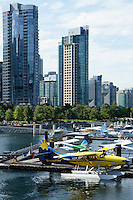 Float planes or sea planes docked at the Vancouver Harbour Water Airport in Coal Harbour, Vancouver, BC, Canada