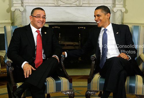 United States President Barack Obama (R) listens to President Mauricio Funes (L) of El Salvador during their meeting in the Oval Office at the White House on Monday, March 8, 2010 in Washington, DC. Funes was the first Central American leader that Obama has met since he took office. .Credit: Alex Wong - Pool via CNP