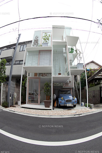 "June 11, 2012, Tokyo, Japan - The transparent house ""House NA"" designed by Sou Fujimoto is located in a residential area of Tokyo, Japan. The concept of the design is associated with the concept of living in the trees. This 914 square-foot transparent house contrasts with the other houses made of concrete or wood around it."
