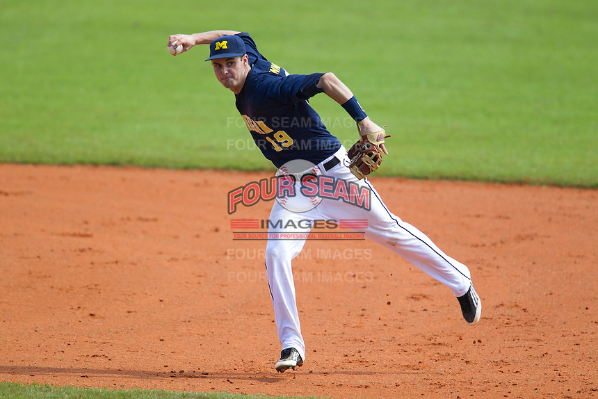 Michigan Wolverines shortstop Derek Dennis #19 throws to first during a game against the Seton Hall Pirates at the Big Ten/Big East Challenge at Al Lang Stadium on February 18, 2012 in St. Petersburg, Florida.  (Mike Janes/Four Seam Images)