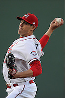 Starting pitcher Pat Light (32) of the Greenville Drive delivers a pitch in a game against the Charleston RiverDogs on Wednesday, April 16, 2014, at Fluor Field at the West End in Greenville, South Carolina. Light was a supplemental pick (37th overall)  by the Boston Red Sox in the 2013 First-Year Player Draft. Charleston won, 8-7, but Light had no decision.  (Tom Priddy/Four Seam Images)