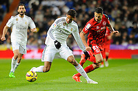 Real Madrid´s Raphael Varane and Sevilla's Vitolo during 2014-15 La Liga match between Real Madrid and Sevilla at Santiago Bernabeu stadium in Alcorcon, Madrid, Spain. February 04, 2015. (ALTERPHOTOS/Luis Fernandez) /NORTEphoto.com