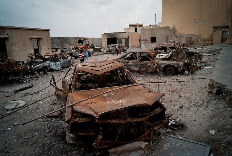 Burt out cars in the main police station in Tobruk, LIbya.
