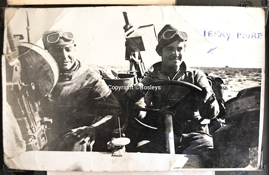 BNPS.co.uk (01202 558833)<br /> Pic: Bosleys/BNPS<br /> <br /> North Africa - 1st SAS in their trademark heavily armoured jeeps.<br /> <br /> Sold for £25,000 - An extraordinary wartime archive that lift's the veil on the earliest days of the SAS during WW2.<br /> <br /> The late Fred Casey was among the original dozen members of the 1st Special Air Service that was formed in North Africa to wreak havoc behind enemy lines.<br /> <br /> The commando's military possessions included a remarkable album containing previously unseen images of the founding members of the elite force.<br /> <br /> Legendary Captain David Stirling, who formed the 'Who Dares Wins' regiment, and hand-picked the men under his command, is pictured along with his controversial deputy Paddy Mayne , who took over the top secret regiment after Stirling's capture.<br /> <br /> The album sold at Bosley's Auctioneers of Marlow, Bucks, last week for over five times its pre-sale estimate..