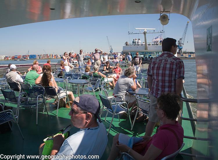 People enjoying sunshine on deck of Spido tour boat, Port of Rotterdam, Netherlands