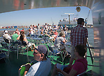 People enjoying sunshine on deck of Spido tour boat, Port of Rotterdam, Netherlands