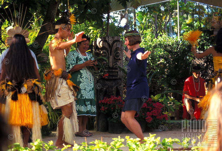 Young dancer teaches a female tourist dances of Tahiti at the Polynesian Cultural Center