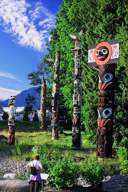 The totem poles at Brockton Point in Stanley Park, Vancouver, with mountains of North Vancouver in the background.