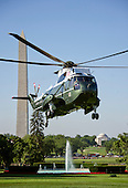 Summer morning view of Marine One as it prepares to land on the South Lawn of the White House to pick-up United States President Barack Obama who will depart to travel to Ottawa, Canada to participate in the North American Leaders' Summit on Wednesday, June 29, 2016.  The President will return to the White House later this evening.  The Washington Monument and Jefferson Memorial are visible behind Marine One.<br /> Credit: Ron Sachs / CNP