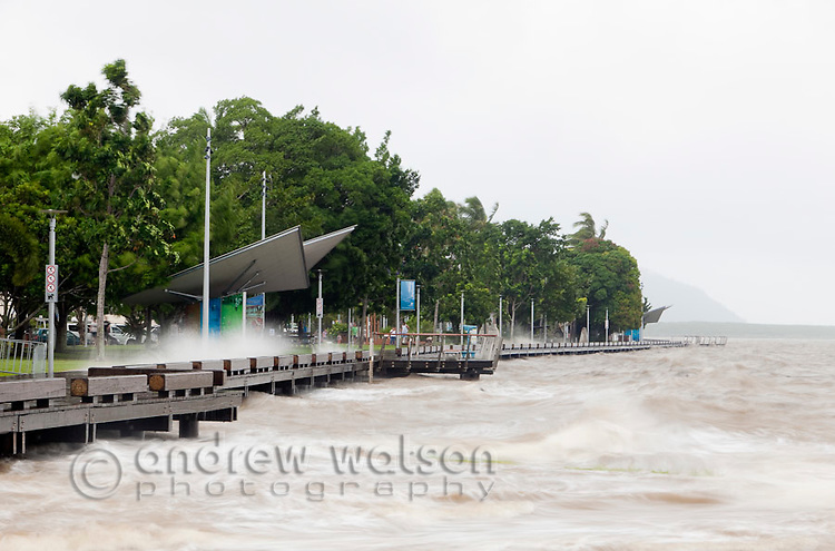 Storm surge along the Cairns Esplanade.  Cairns, Queensland, Australia