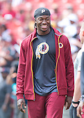 Washington Redskins quarterback Robert Griffin III (10), who was declared inactive for the game against the Miami Dolphins, watches as his teammates warm-up at FedEx Field in Landover, Maryland on September 13, 2015.<br /> Credit: Ron Sachs / CNP