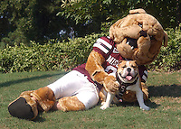 Bully & TaTonka in the grass (photo by Russ Houston / © Mississippi State University)