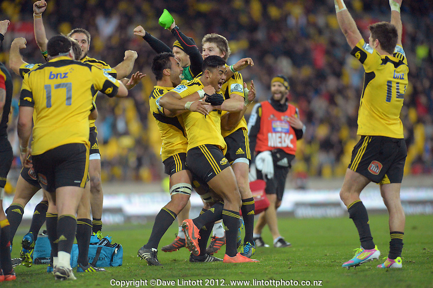Hurricanes players celebrate as the TMO awards Dane Coles' match-winning try after the final hooter during the Super 15 rugby match between the Hurricanes and Chiefs at Westpac Stadium, Wellington, New Zealand on Friday, 13 July 2012. Photo: Dave Lintott / lintottphoto.co.nz