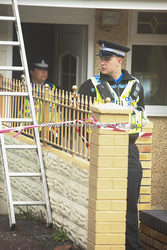 Pictured: A police officer outside the house in the Alltwen area of Pontardawe, south Wales where a four year old boy died in a fire. Wednesday 27 July 2016<br /> Re: A four-year-old boy has died following a fire at a house in Neath Port Talbot.<br /> Fire crews were called to the property in Lon Tanyrallt, Alltwen, near Pontardawe, at 1.40am on Wednesday.<br /> They rescued the boy from an upstairs bedroom in the two-storey semi-detached house but he died at the scene.<br /> A three-year-old boy was also rescued and take to hospital along with his sister, six, and mother who had both managed to escape the blaze.<br /> They were all suffering from suspected smoke inhalation.<br /> Mid and West Wales Fire and Rescue Service said the woman, who is believed to be in her 20s, called for help and neighbours tried to get in to help the stranded children.