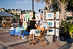 Street artists sell their crafts on the Mallory Square dock.