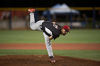 Salem-Keizer Volcanoes relief pitcher Alex DuBord (49) follows through on his delivery during a Northwest League game against the Hillsboro Hops at Ron Tonkin Field on September 1, 2018 in Hillsboro, Oregon. The Salem-Keizer Volcanoes defeated the Hillsboro Hops by a score of 3-1. (Zachary Lucy/Four Seam Images)