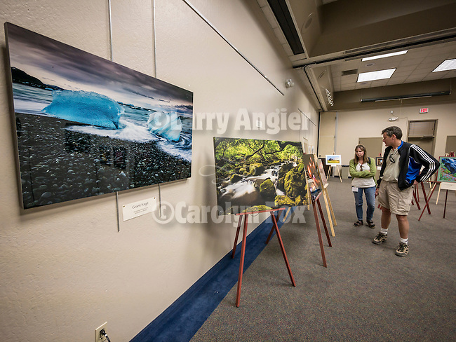 Display of photos by presenters in the main hall, Saturday at Shooting the West XXVII, Winnemucca, Nev.