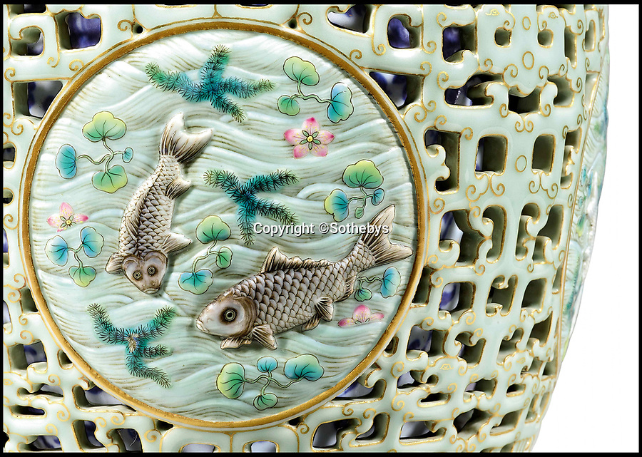 BNPS.co.uk (01202 558833)<br /> Pic: Sothebys/BNPS<br /> <br /> The rediscovered vase features four roundels of different fishes.<br /> <br /> A 'lost' Chinese vase has sold for a whopping £14.6m - eight years after its matching twin went under the hammer at a British auction house for £43m.<br /> <br /> It means the identical pair of 16ins tall antiques are worth a combined £57.6m.<br /> <br /> The first 18th century Qianlong vase took the antiques world by storm after solicitor Tony Johnson and his mother Gene offered it for sale in 2010.<br /> <br /> The 16ins item sold for the astonishing sum to a wealthy Chinese collector.<br /> <br /> Now its missing pair, that had been kept in the same family for 90 years, has sold.
